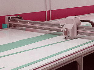 Sail making with vacuum table. Configure with plotter or cut by hand with more control.