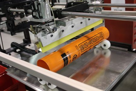 plastic tube, screen printer, screen printing, systematic automation, warning label.