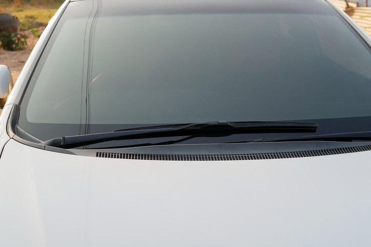 Windshield wipers of a white car