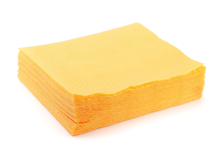 Stack of yellow paper napkins isolated on white